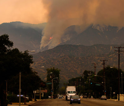 """The US National Weather Service has issued a """"red flag warning"""" for the West Coast, as high winds threaten to spread wildfires further."""